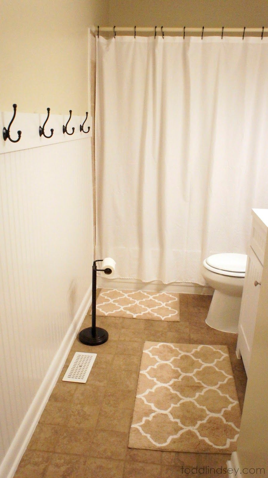 Beadboard Wall In Bathroom With Hooks For Towels