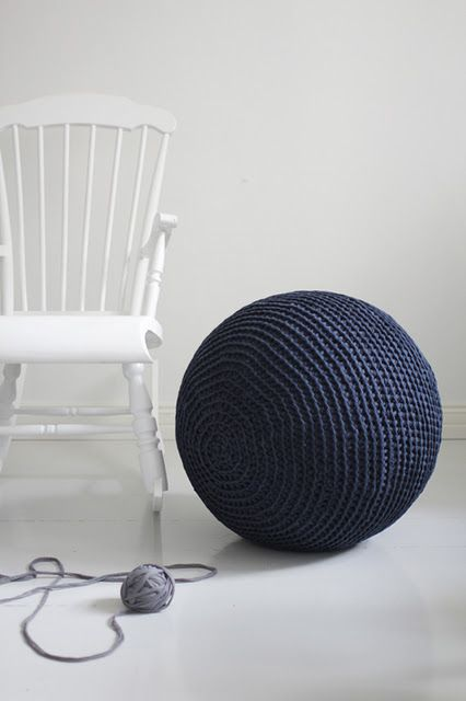 Giant crochet ball.  I think this would be hilarious with a pair of huge knitting needles, next to a high chair like that, for baby portraits.