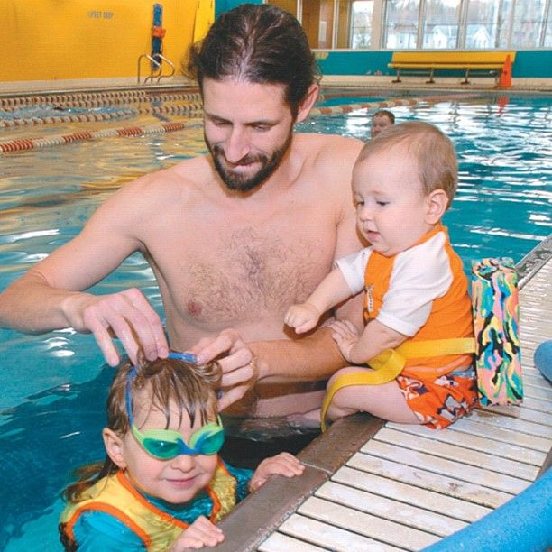 Jason Novak with sons Cedar, 2, and Jasper, 8 months, at the YMCA in Kingston. You figure out who's who.