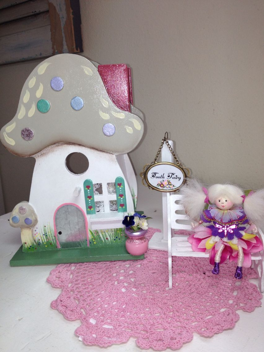 Tooth Fairy house made from a birdhouse. Doll made from pipe cleaners, a bead for head, silk flower parts, scraps of trims and wool roving. Made for my daughter as a special little remembrance. As a child she wrote notes to this special fairy and tucked them under her pillow.