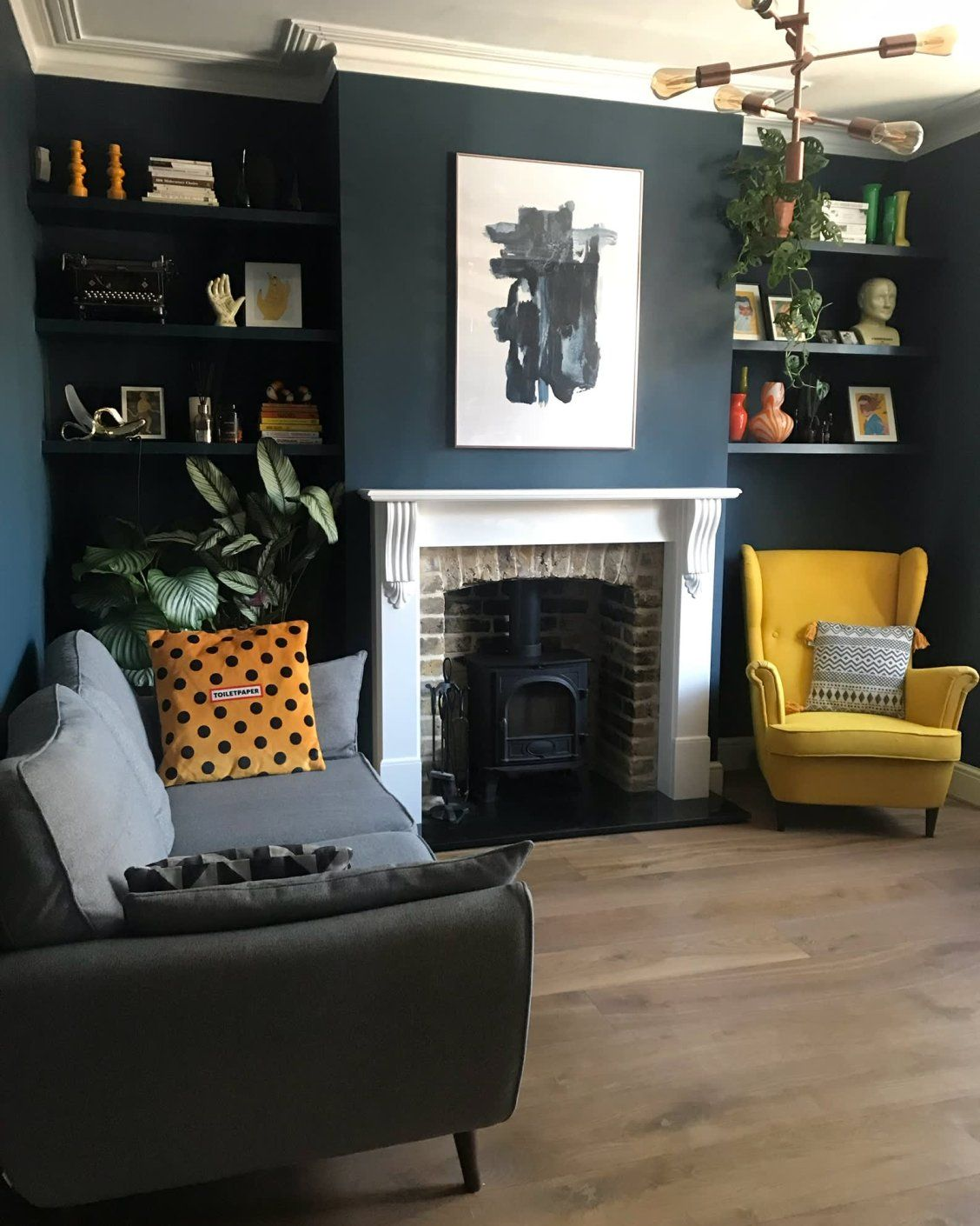 Color Blocked Furniture And A Moody Forest Mural Make This London Home Living Room Transformation Living Room Update Dark Living Rooms