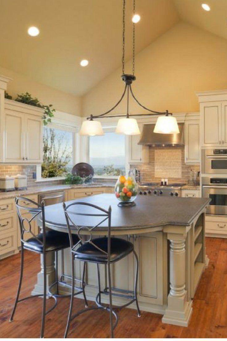 Kitchen with large custom island in the center and cathedral ceiling above top designs luxury kitchens design also rh pinterest