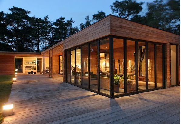 Modern Design - horizontal wood siding and vertical windows .