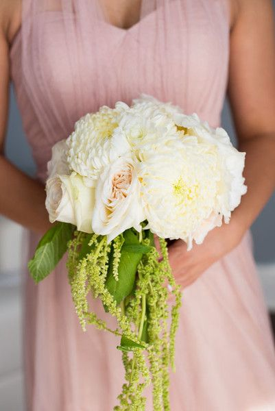 <strong class='info-row'>Callawaygable</strong> <div class='info-row description'>The bridesmaids' bouquets featured roses and peonies too.     Photo: Lauren Belknap    Bridesmaid Dresses: Jenny Yoo    Floral Designer: Tustin Florist</div>