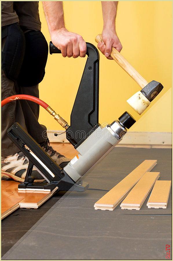 Hardwood Floor Installation Man Installing Tongue And Groove Hardwood Floor Spon Installa In 2020 Installing Hardwood Floors Floor Installation Wood Floor Installation