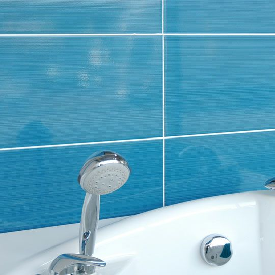 Brighton Blue 25x40 Cm Is A Ceramic Gloss Wall Tile With A Line Pattern By British Ceramic Tiles