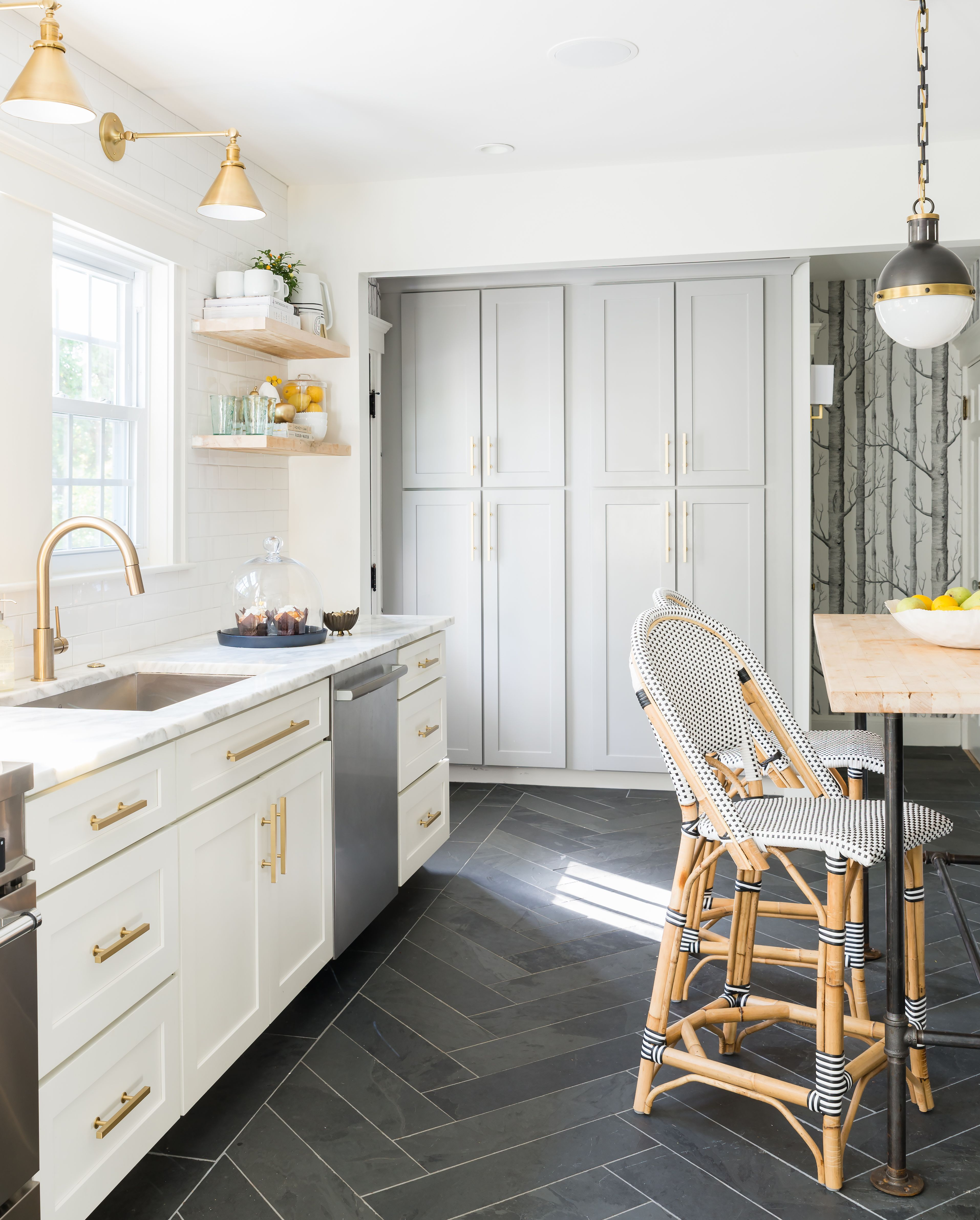 White grey brass kitchen with herringbone tile floor