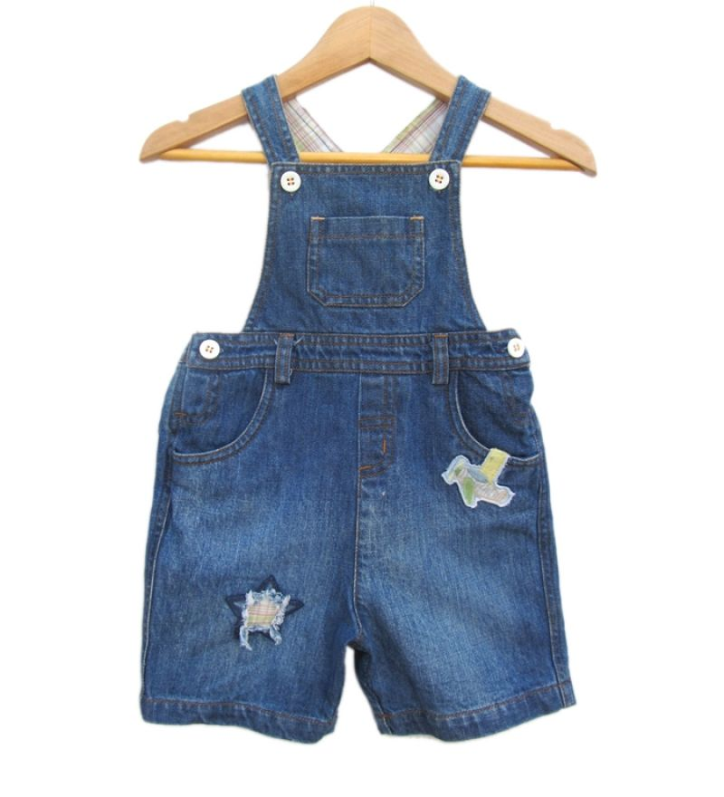 Beebay Denim Half Dungree:-Dungarees lend your kids that special look and style statement that is usually desired by elders! Made from denim and sporting its classic blue color, this garment will soon become your kids favorite!