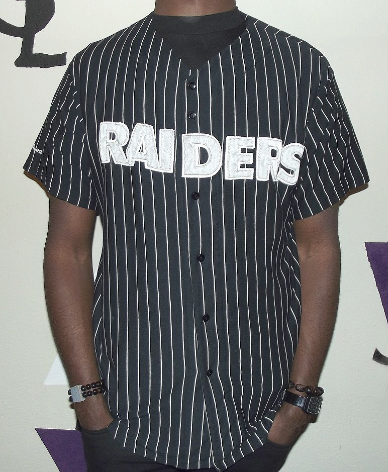THIS RAIDERS BASEBALL JERSEY IS ALL BLACK WITH SILVER SHINY FONT  amp   WHITE PINSTRIPE. 76a68e8058c