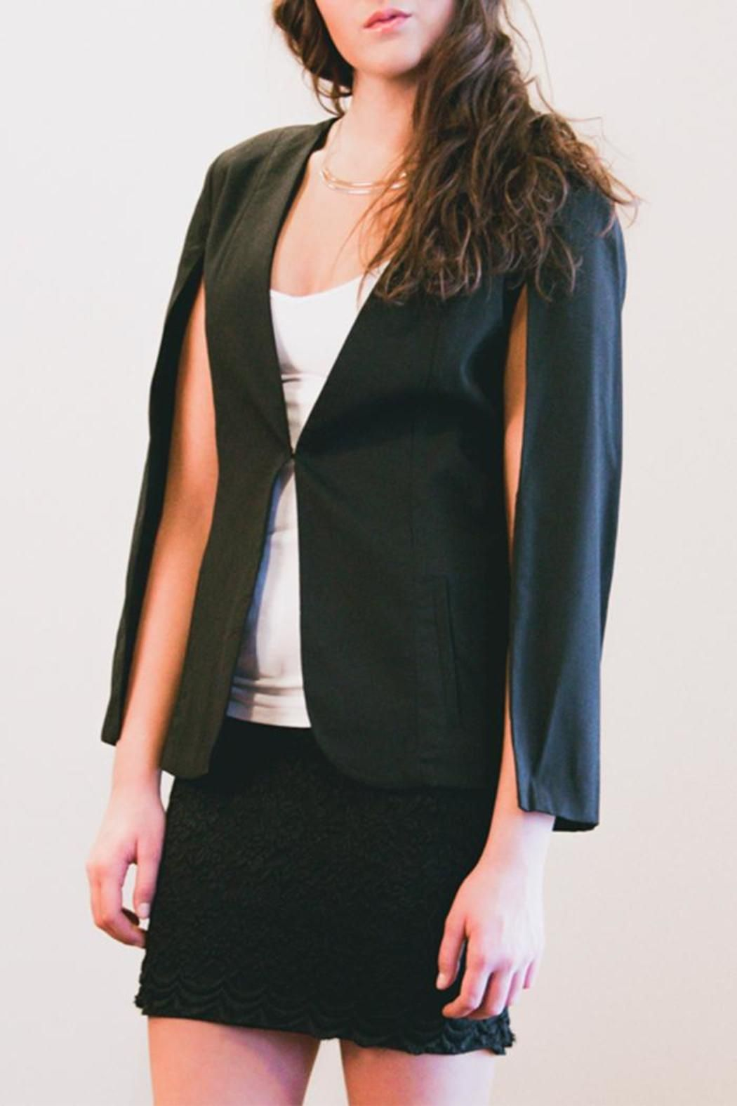 Throw this sleek black cape blazer on for an insta-chic look! Fully lined. Hook and eye closure in front.    Black Cape Blazer by Sparrow. Clothing - Jackets, Coats & Blazers - Jackets - Blazers Michigan