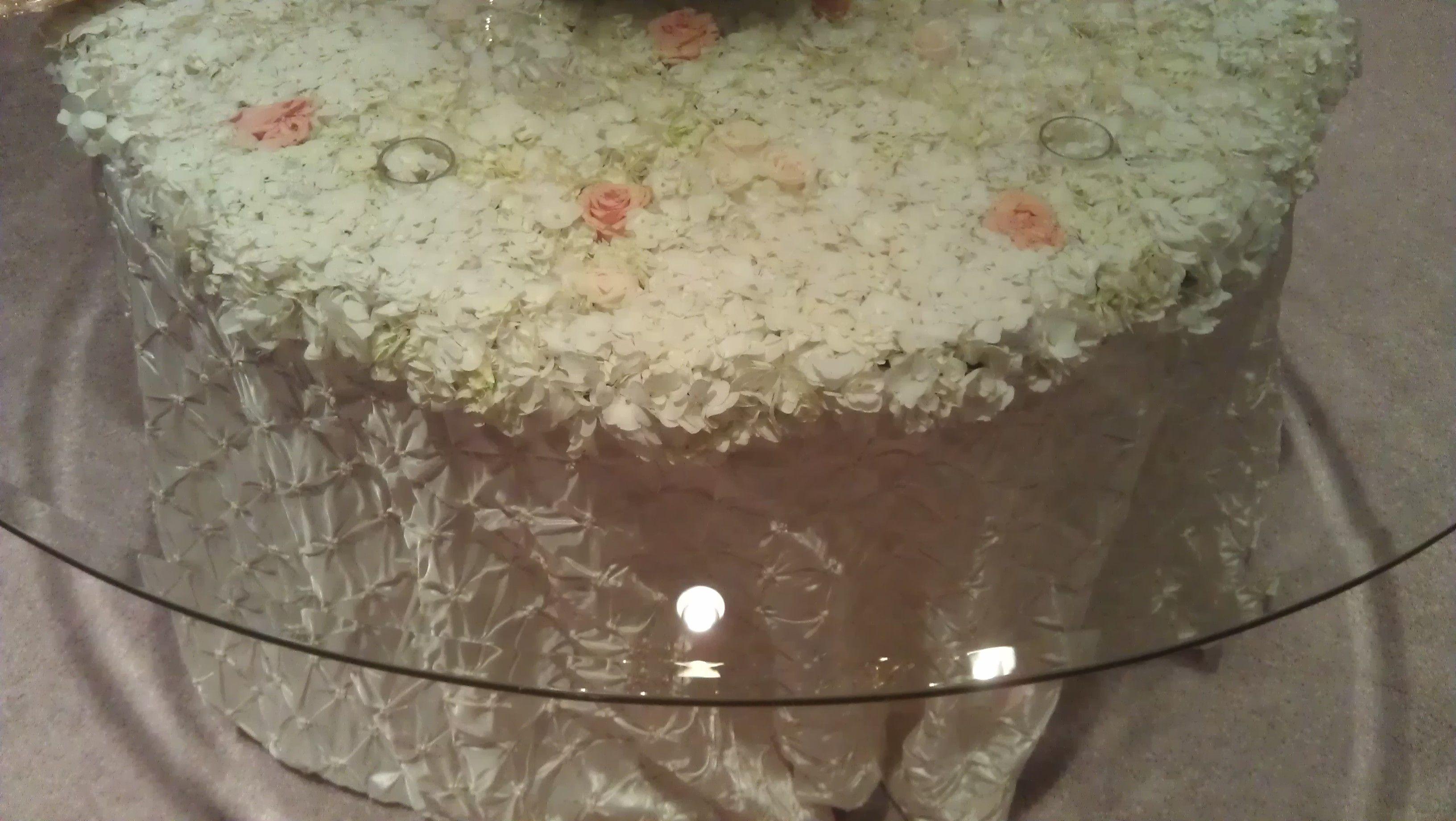 white hydrangea table top under glass