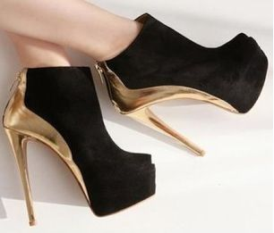 Gold back and heel. Black boot. Love