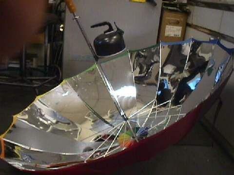Sunbrella Solar Cooker Made From An Umbrella Solar Oven Solar Cooker Solar Energy Diy