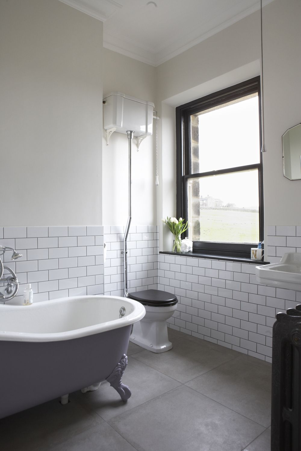 House bathroom. Metro tiles, black painted window, art deco mirror ...