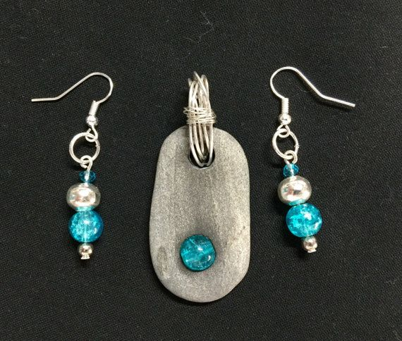 Beach Rock pebble collect from my lovely local beaches on the north coast of NSW, Australia. $18 for the set. This rock is set with a stunning blue glass crystal bead and finished with silver wire. Matching earrings complement this lovely pendant. Jewellery