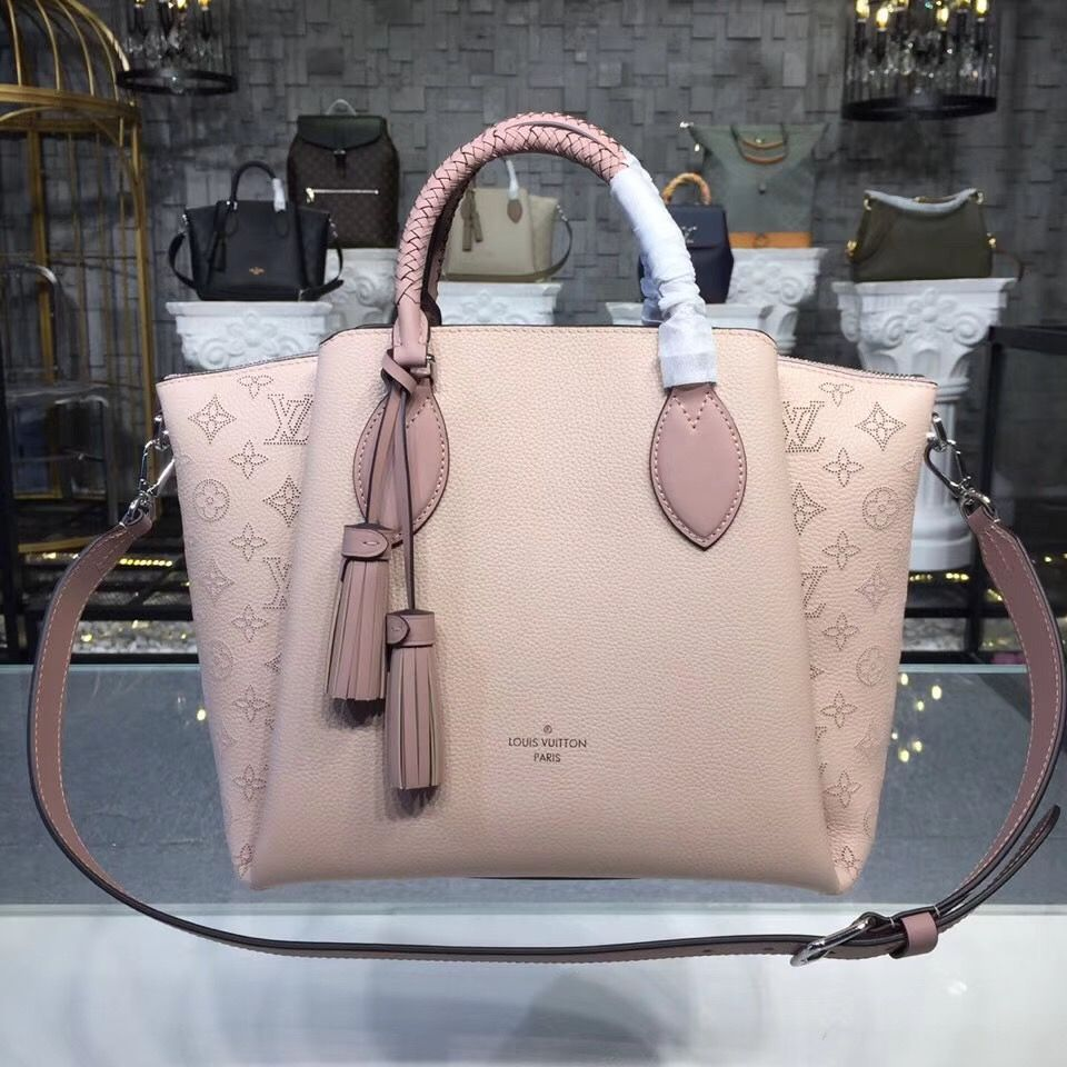 f52f06242901 Purchase a Louis Vuitton Mahina Leather Haumea Bag Magnolia M55030 at  bargain rate- USD 480. Free Worldwide Shipping by courier
