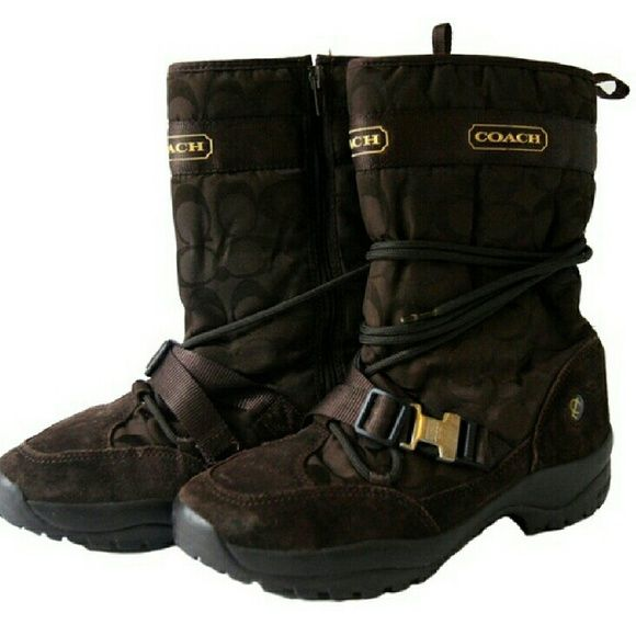 COACH SELA BOOTS Nice Coach black  signature  boots with Coach emblems and vibram soles. Buckle and tie detail. Ties can be worn different ways. No wear on soles, gently worn very good condition. Coach Shoes Winter & Rain Boots