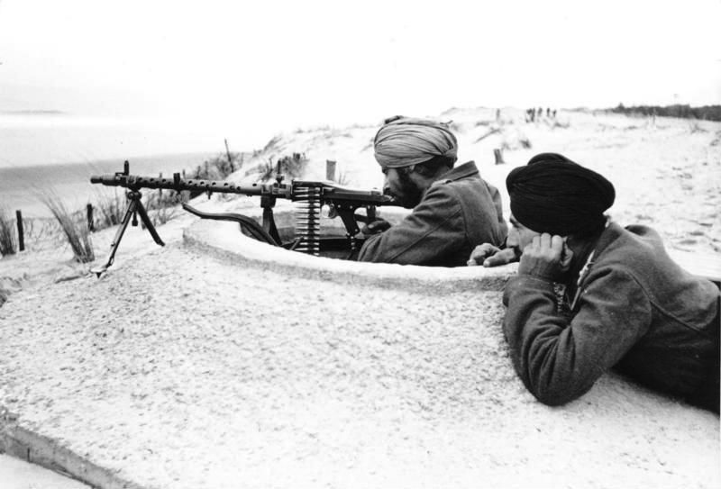 Legion Freies Indien or The Indian Legion served with the German Army, they were used on the Atlantic Wall. Seen here are two manning a MG34 which were mounted in small concerte 'spider' holes manned by one man.