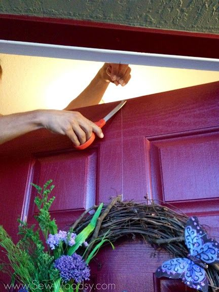 Use A Flat Thumbtack To Hang A Wreath On A Door