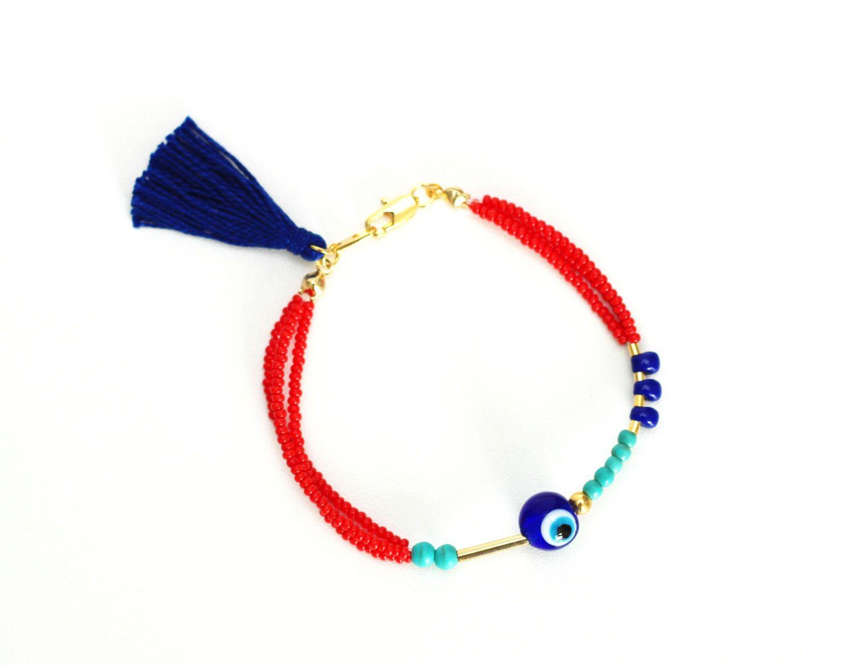 Navy Blue Evil Eye Bracelet, Beaded Friendship Bracelet, Seed Bead Bracelet, Red Beaded Bracelet, Red Bracelet, Tiny Beads, Navy Tassel by HippieThings on Etsy https://www.etsy.com/listing/243329689/navy-blue-evil-eye-bracelet-beaded