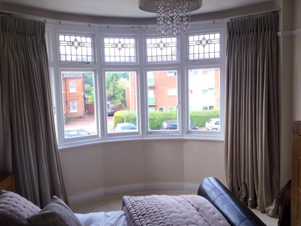 Double pleated interlined curtains dress this beautiful bay window adding the finishing touches