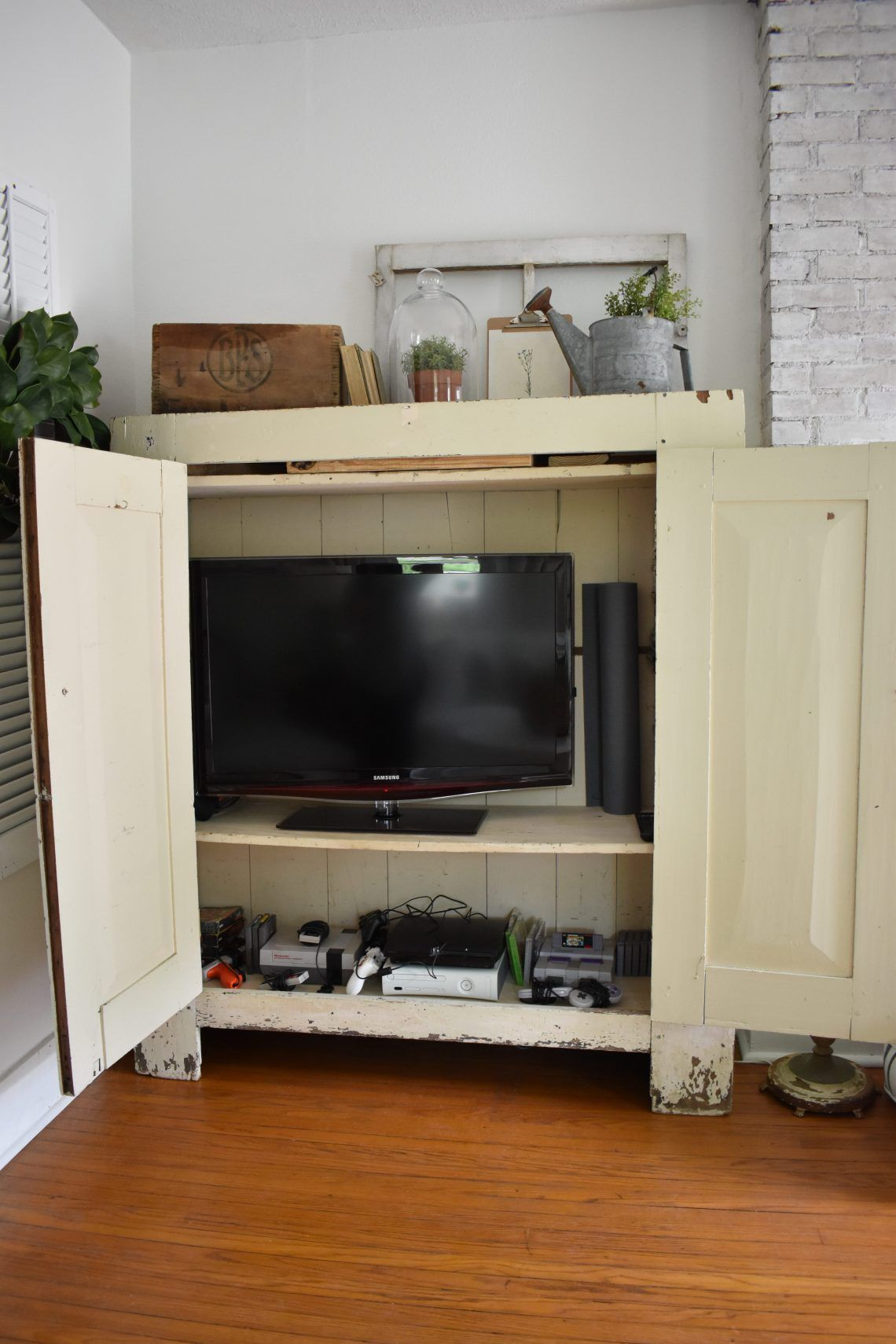 Repurposing an old cupboard into a media center midcounty journal
