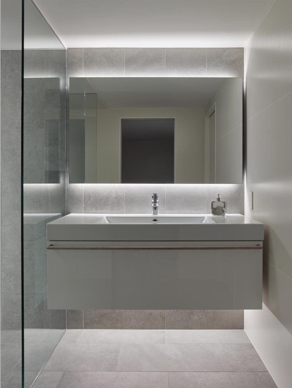 A Custom Vanity And Mirror Appear To Float On The Wall Mirrored Vanity Bedroom Backlit Bathroom Mirror Led Mirror Bathroom