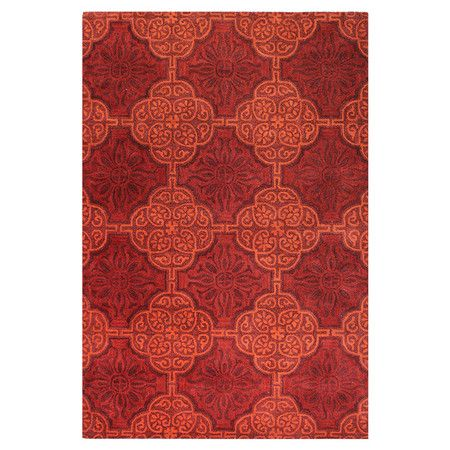 Hand-tufted wool rug with medallion lattice motif.  Product: RugConstruction Material: 100% WoolColor: