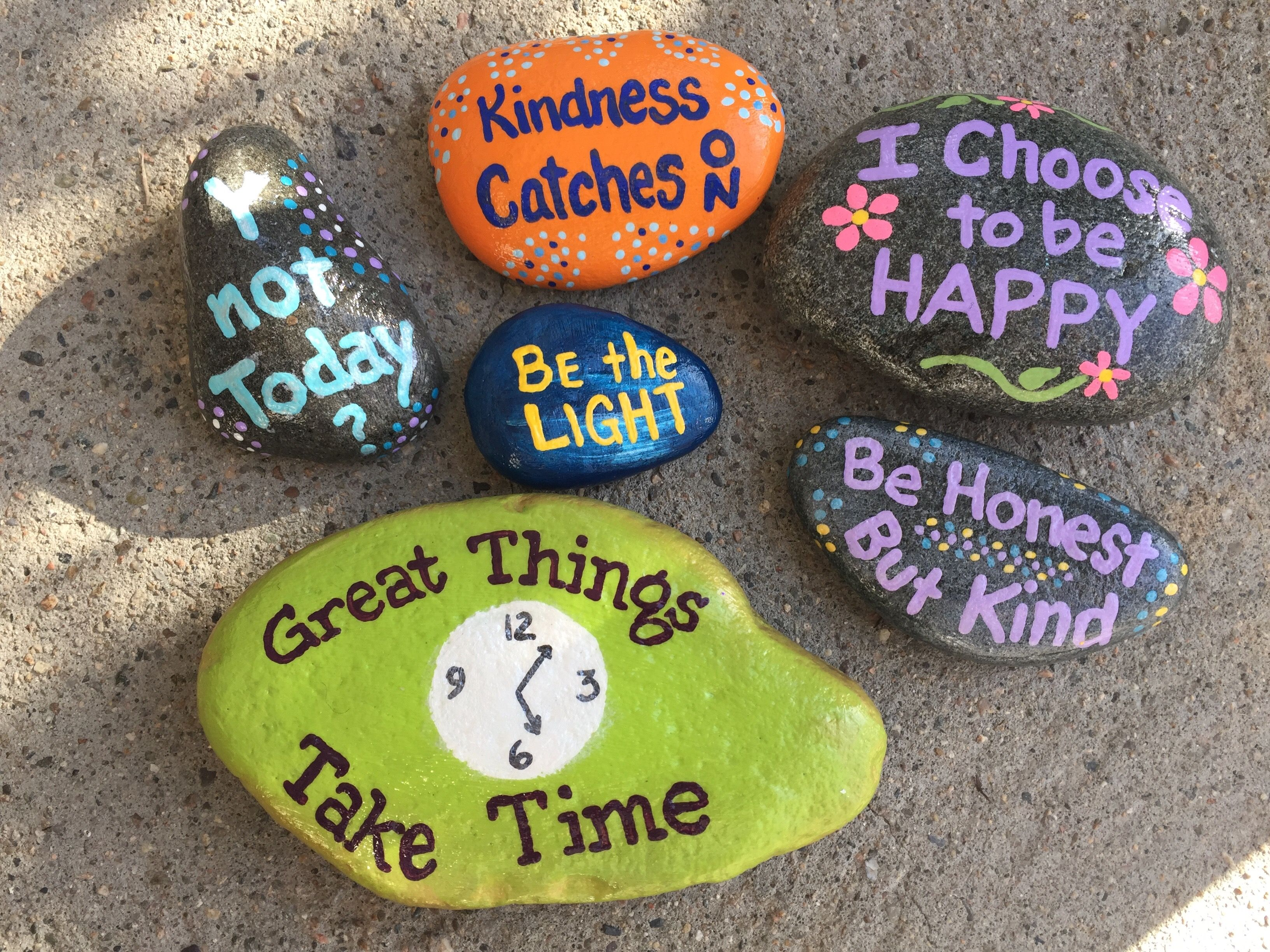 Hand painted rocks by Caroline. The Kindness Rocks Project.