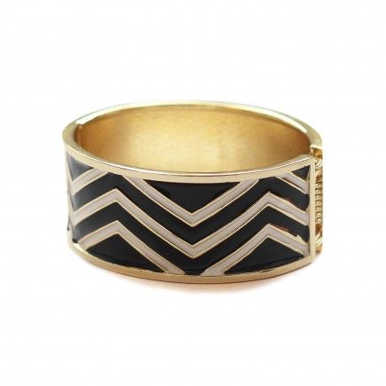"Geometric Cuff | Our love for chevron and geometric has translated into jewelry as well. Pile up this limited edition black, white and gold chevron cuff with other gold bracelets to add edge to your look. This cuff snaps on with ease and measures 2.4"" and 1.9"" (inside diameter) and 2.6"" and 2.1"" (outside diameter), 3.1"" high, 9.5"" all around. #Jewelry #Cuff #Fashion www.vintagemaya.com"
