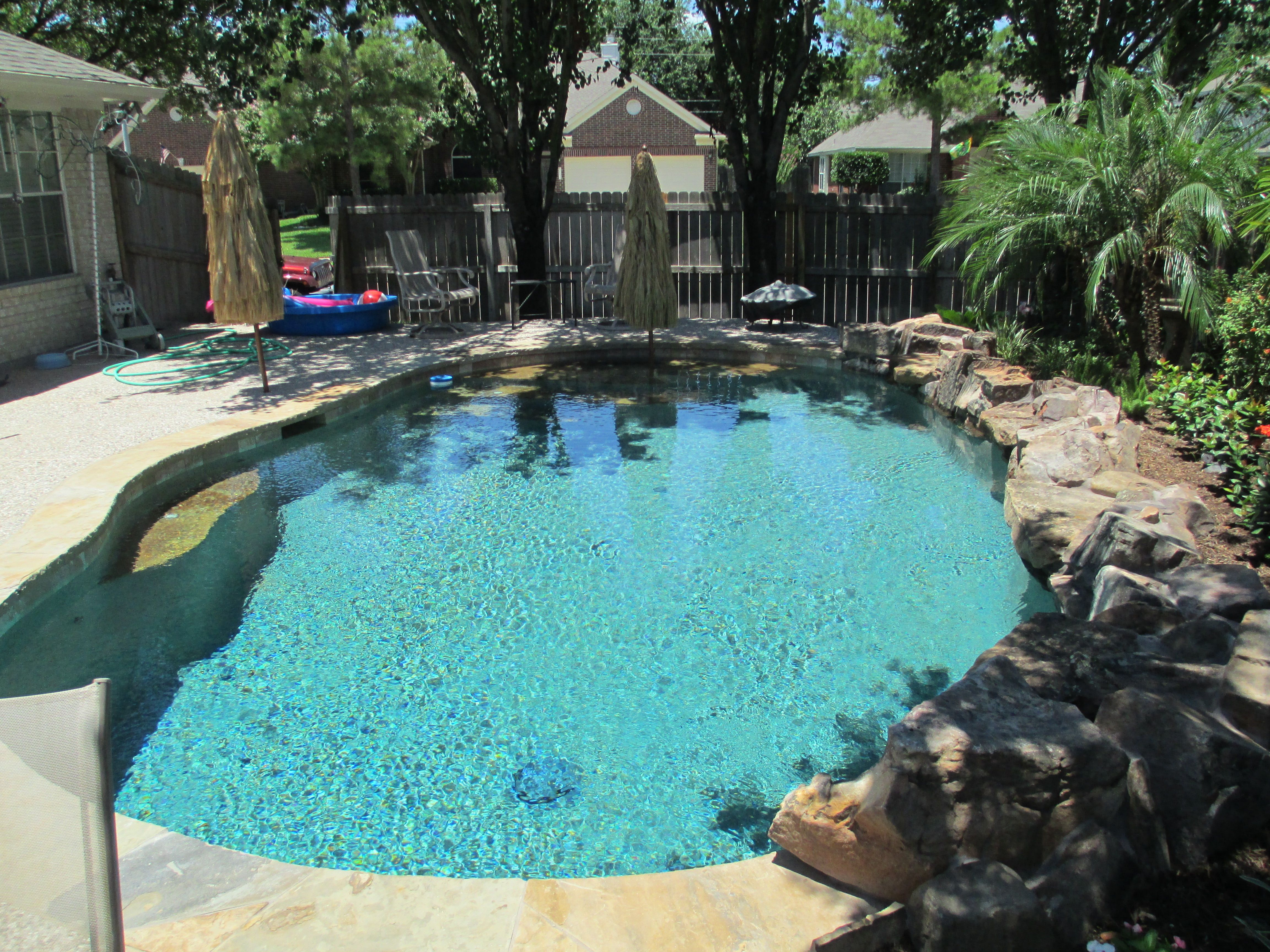 Simple design with water feature | Backyard pool, Custom ...