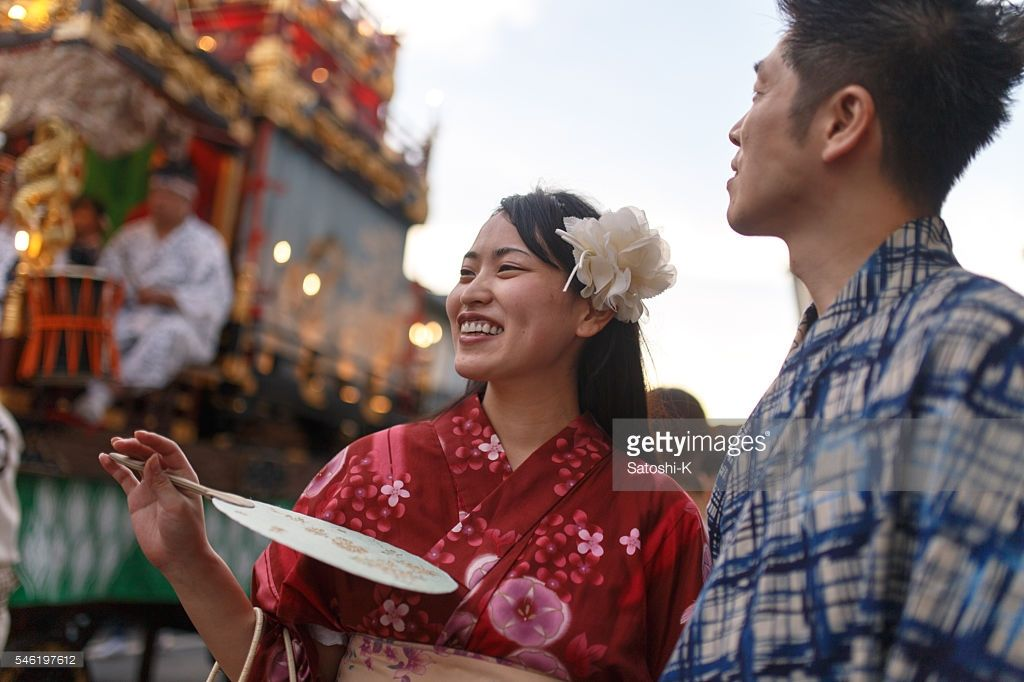ストックフォト : Young couple enjoy watching parade float at festival  #アイストックKAWASE