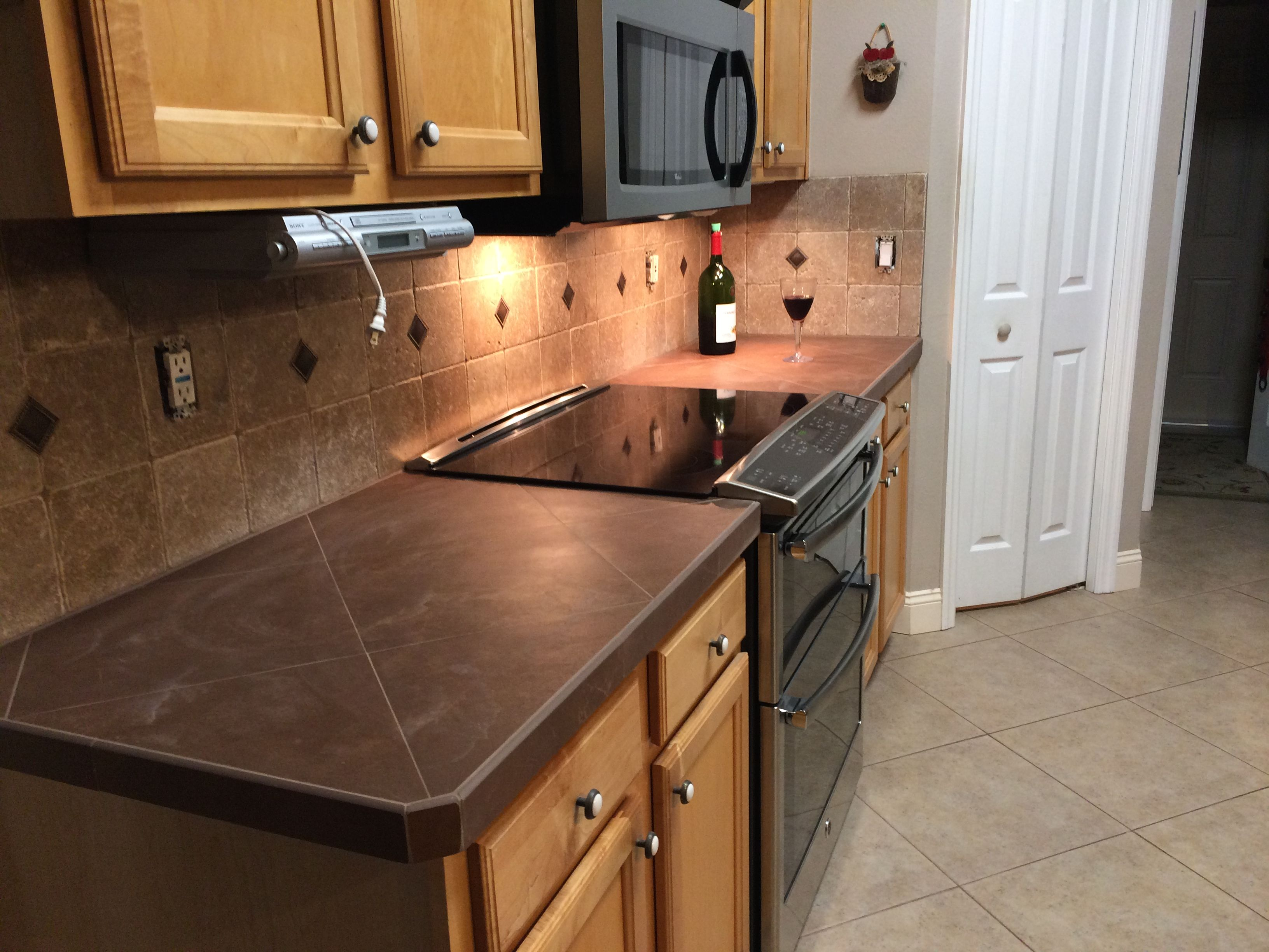 Tiled Kitchen Countertop Right Over Old Almond Color Formica. Added New  Tumbled Stone Backsplash