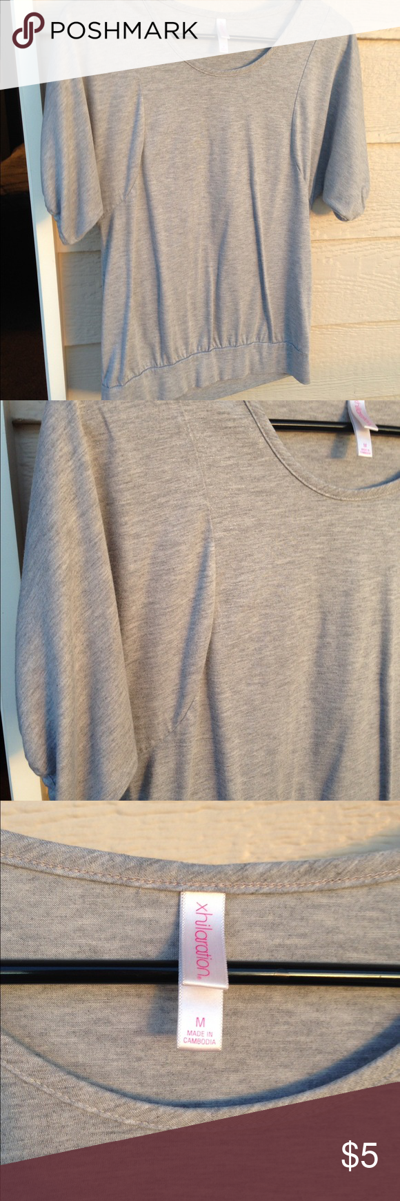 Grey blouse Grey cute fit with seam to shape. Fits like a small. Xhilaration Tops