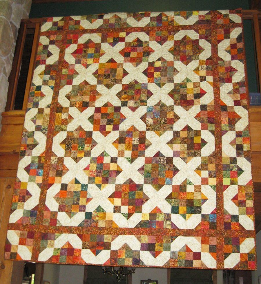 A split nine patch variation by Debbie Caffreys book, \