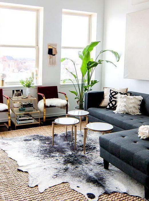 Cowhide Rug Layered Over Natural Fiber Rug Rugs In Living Room Cowhide Rug Living Room Brown Carpet Living Room
