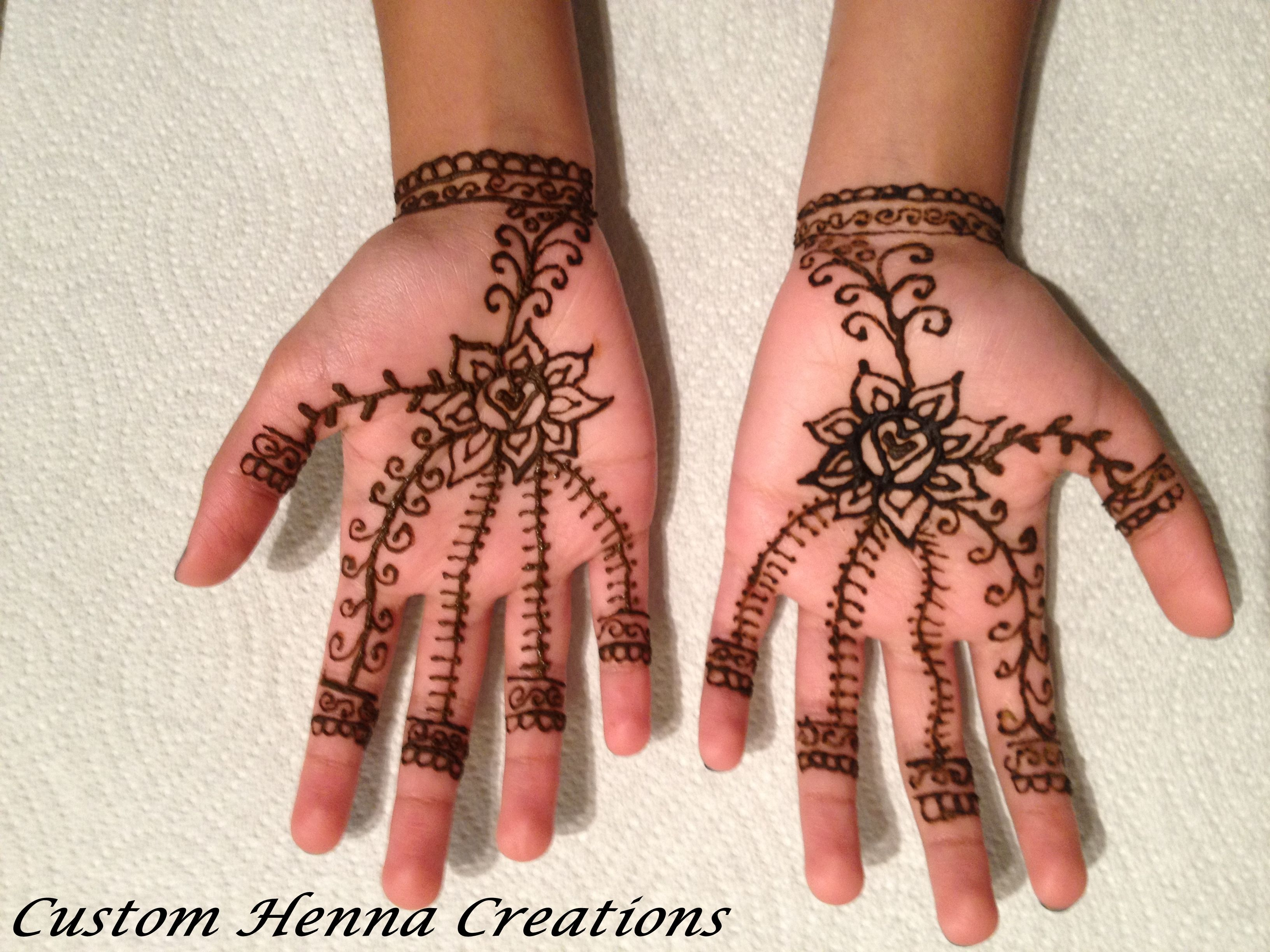 Mehndi Flower Designs For Hands : Henna on hands of child heart and flower design mehndi