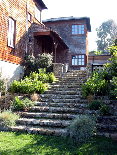 Stair With Planters Leading To The Grass Area.