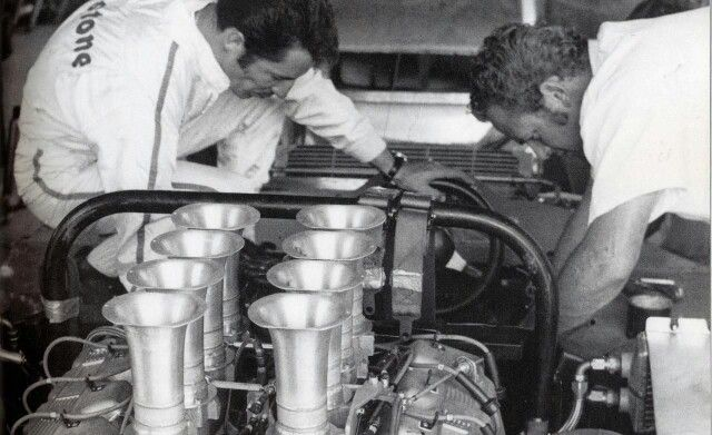 Mario and mechanic at work on the Holman Moody Can Am monster