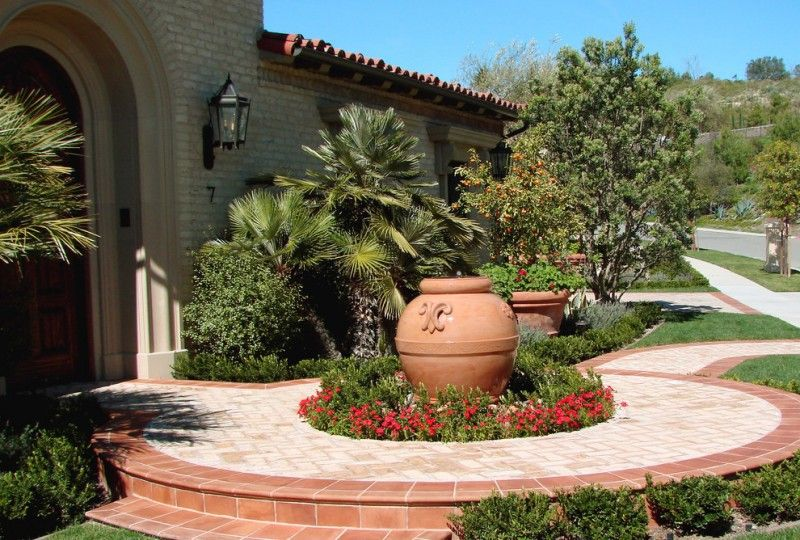 Mediterranean Front Yard Landscape With A Container Garden And Brown