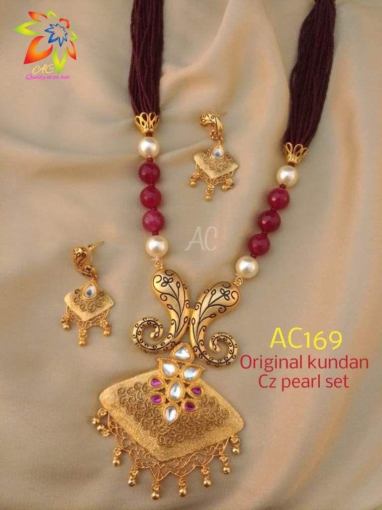 Maroon beads kundan work pendent set designer indian clothing