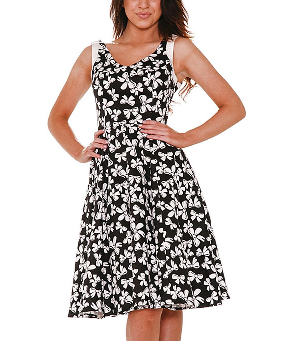 6be0295d17 Love this HEARTS   ROSES LONDON White Bow Dress - Plus Too by HEARTS    ROSES LONDON on  zulily!  zulilyfinds