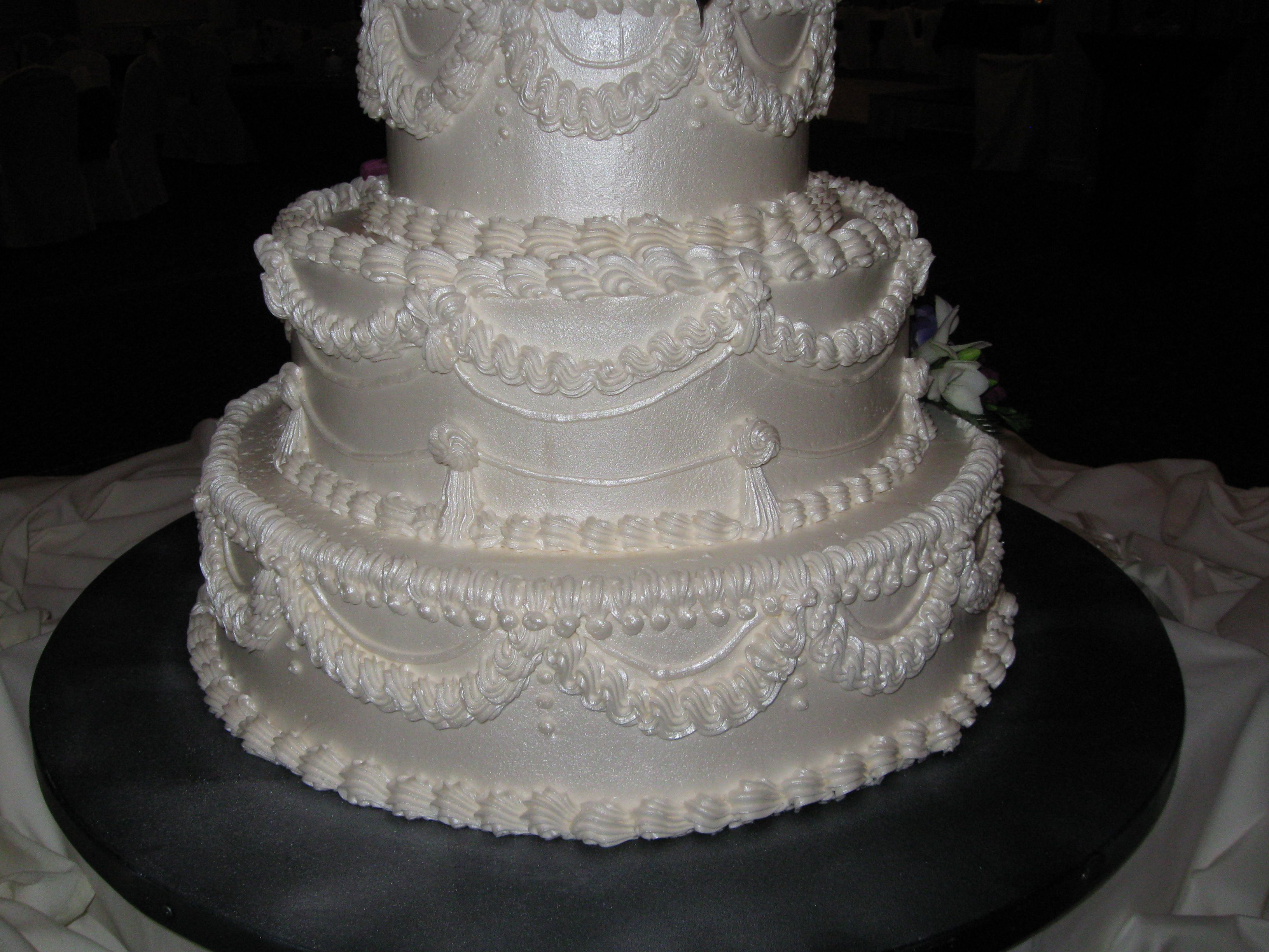White wedding cake 3 tiered white buttercream icing