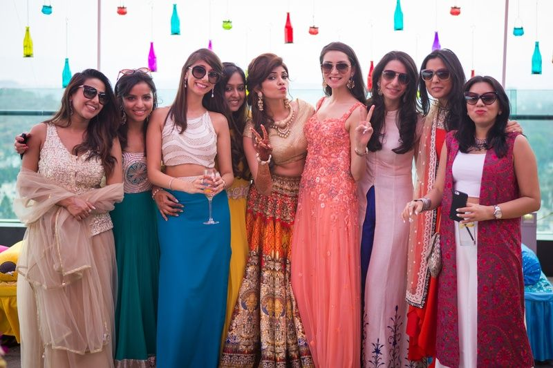 Mehndi Ceremony Outfits : Bridal entrage dressed in glam outfits for an outdoor mehendi