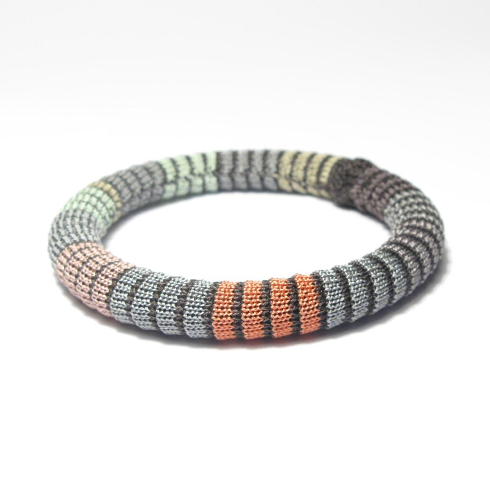 Elinor Voytal: Pixels B |  Hand knitted silk and viscose bangle. (plastic inner)