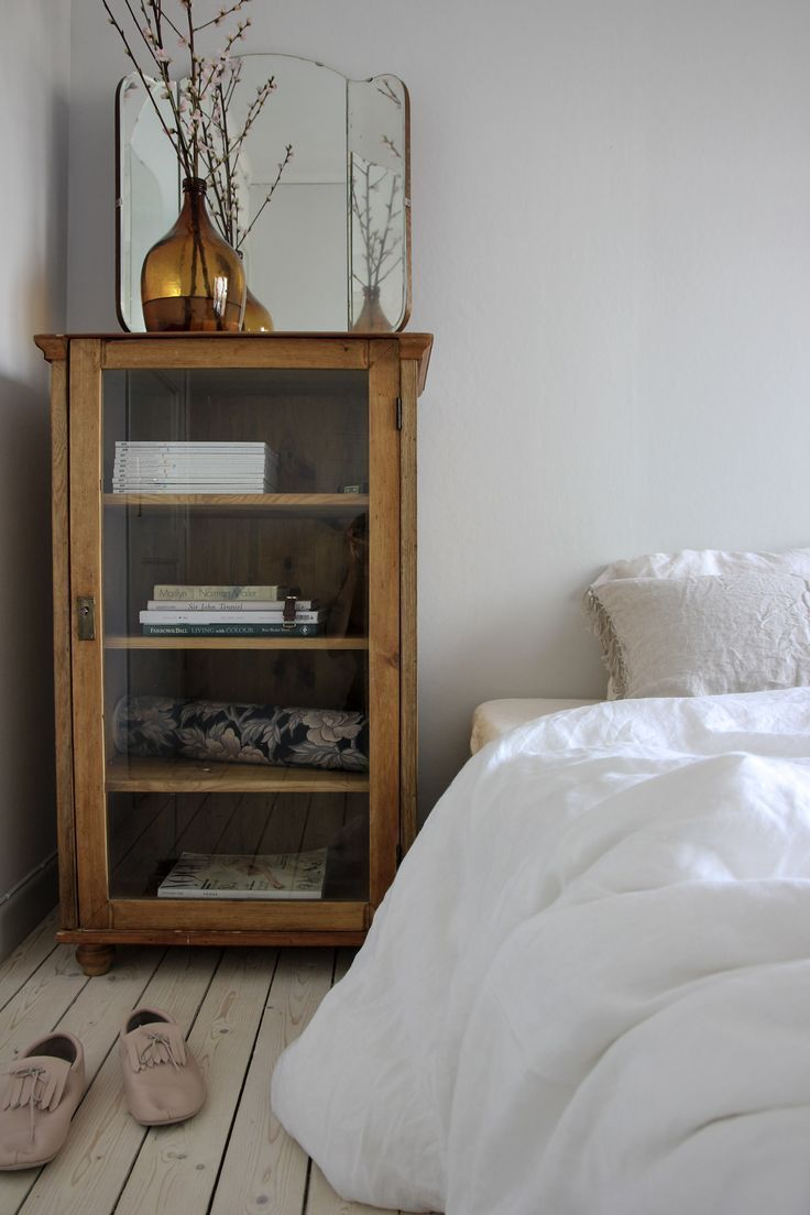 Beautiful glass + wood cabinet as bedside table