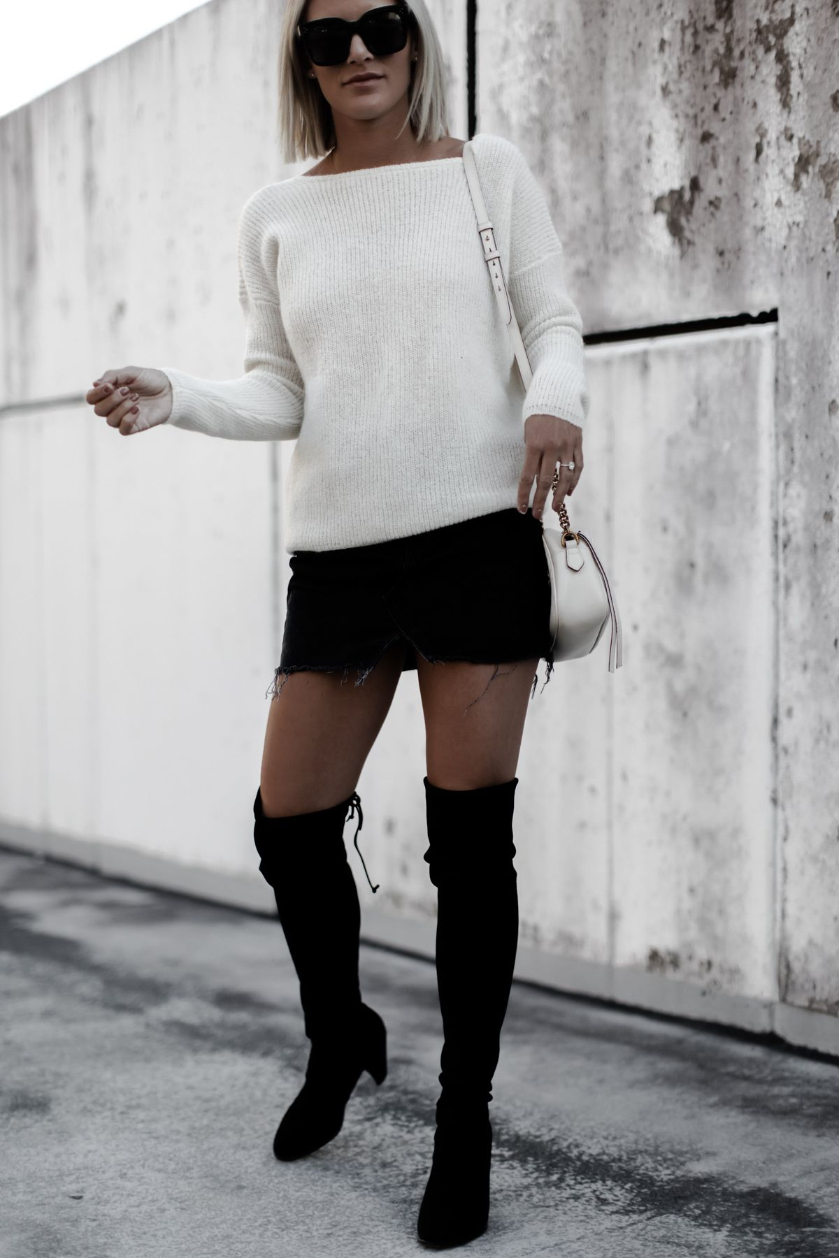 Blogger So Sage in a cream sweater, black skirt, and otk boots ...