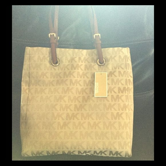 Mk purse/ wallet bundle make offer Make offer if interested, both authentic and new w/ tags. Purse is a the large bag FYI and the wallet is quite large as well. Michael Kors Bags Shoulder Bags