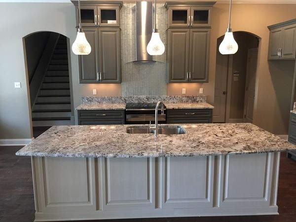 alaska white granite with maple cabinets alaskan countertops perfect combination paired arctic storm stone mosaic tile absolutely gr kitchens