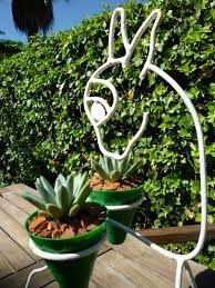 Resultado de imagen para porta maceta de hierro para for Figuras jardin baratas